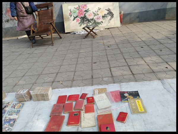 Mao's red bible being sold on a street market in Kaifeng